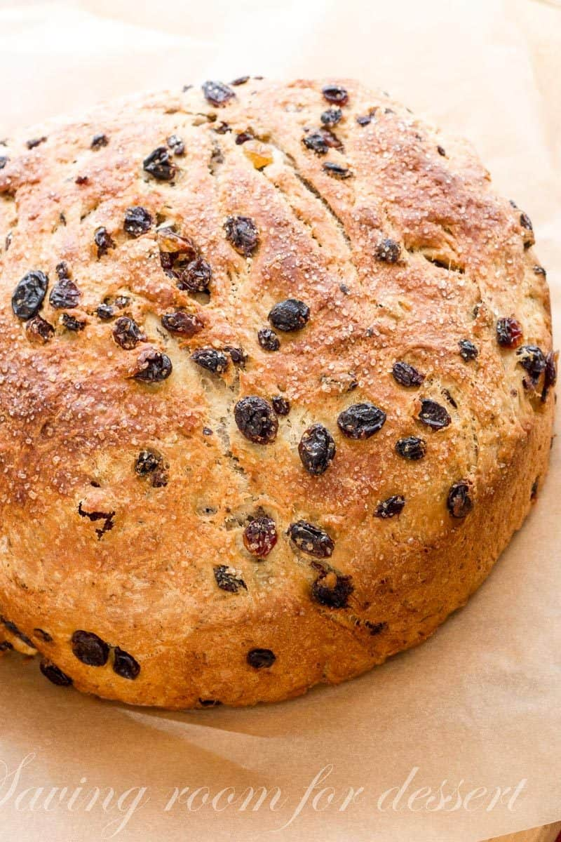 Barm Brack - Irish Halloween Bread - A traditional Irish recipe served around Halloween. Barm Brack is a little sweeter than sandwich bread, but not as rich as cake. The Irish bake items into the bread as a game of fortune-telling. Sometimes there is a ring indicating an impending marriage or a coin foretelling good luck or riches. www.savingdessert.com