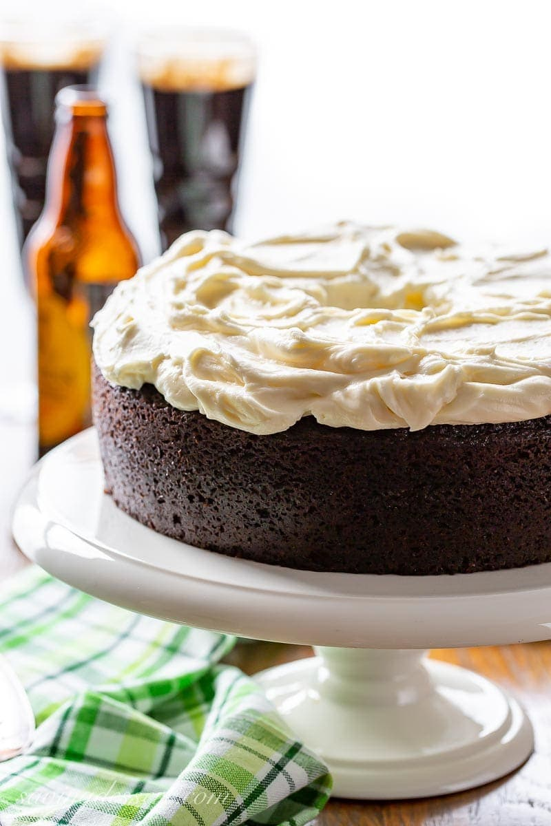 A dark chocolate Guinness Cake on a cake stand