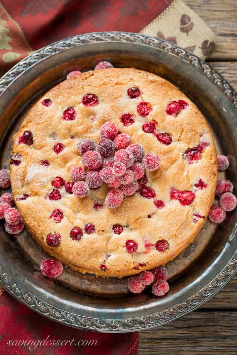 An overhead view of a cranberries cake topped with sugared cranberries