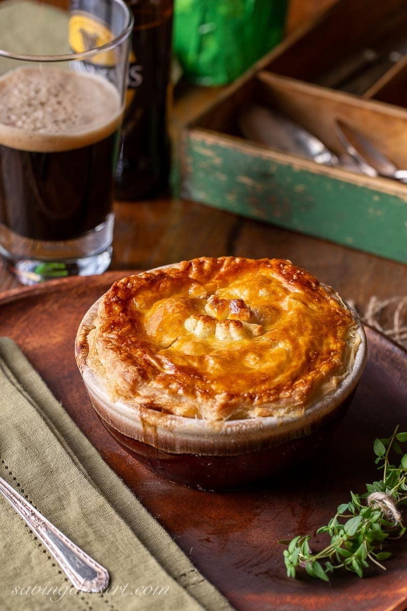 A bowl of Irish beef stew with puff pastry on top