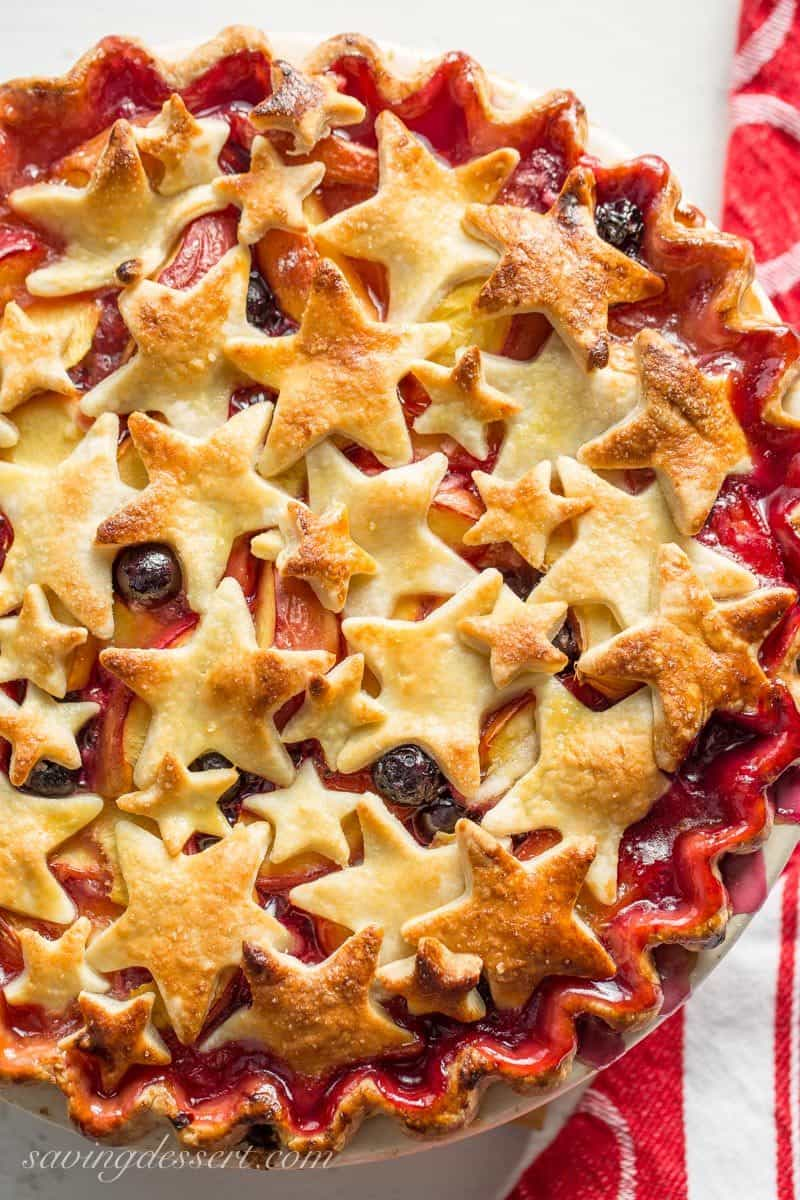 A nectarine and blueberry pie topped with star crust cutouts