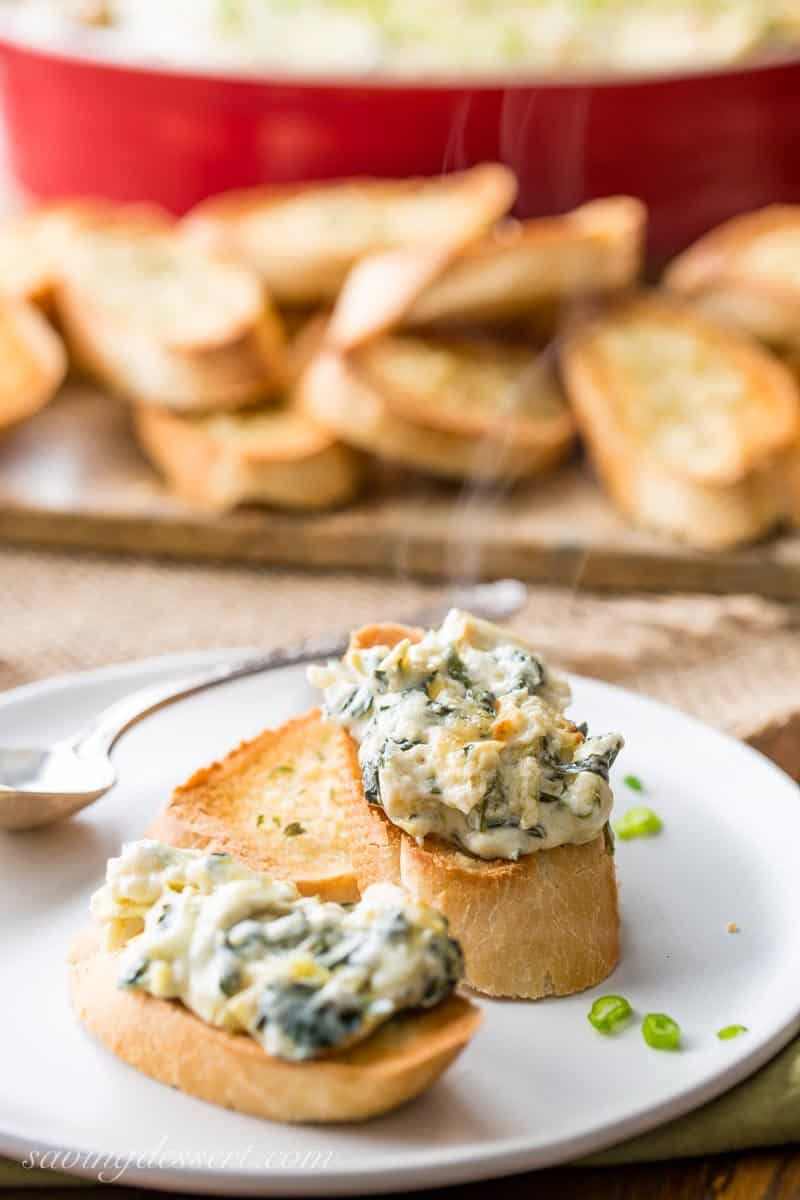 Hot Spinach and Artichoke Dip on toasted baguette slices