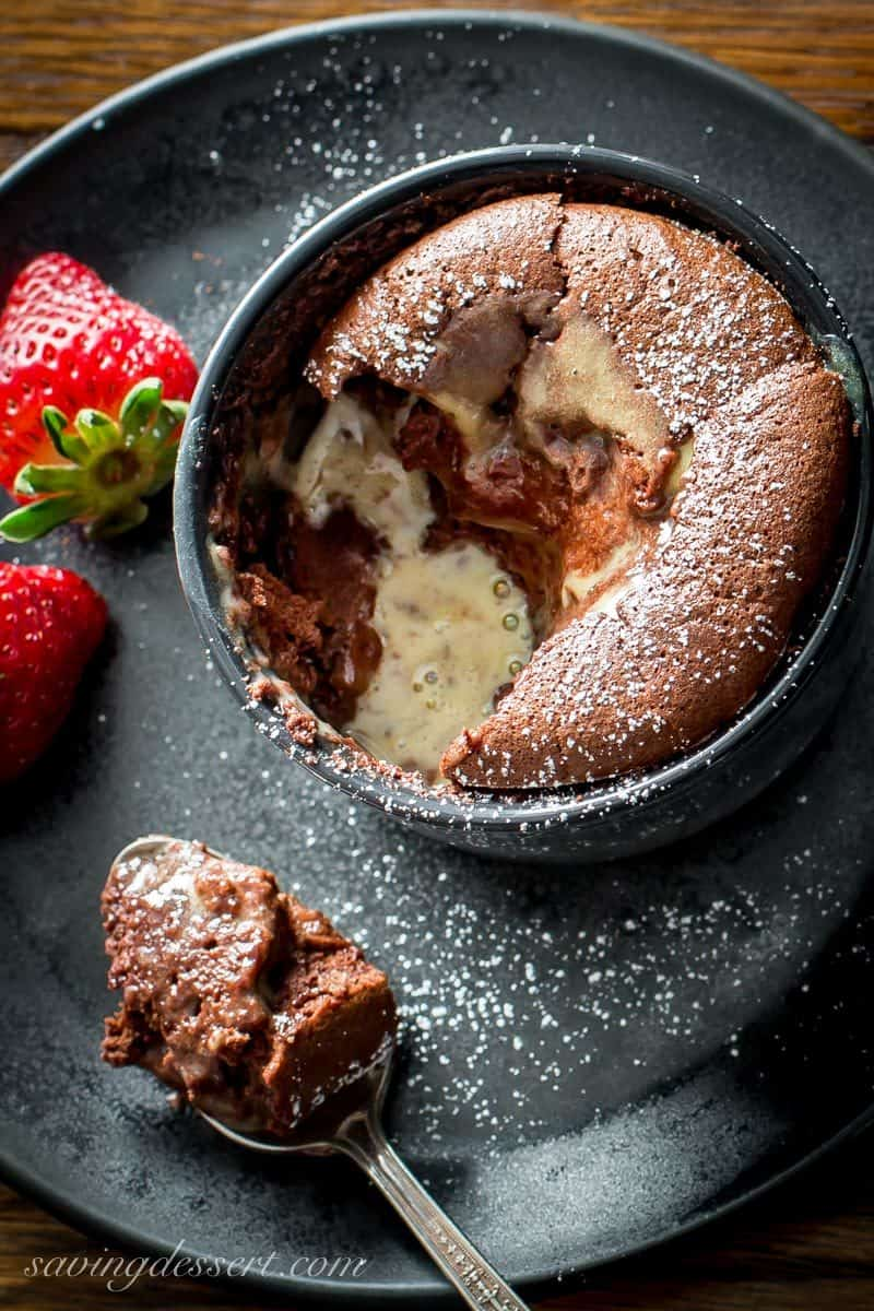spoonful of chocolate souffle with fresh strawberries