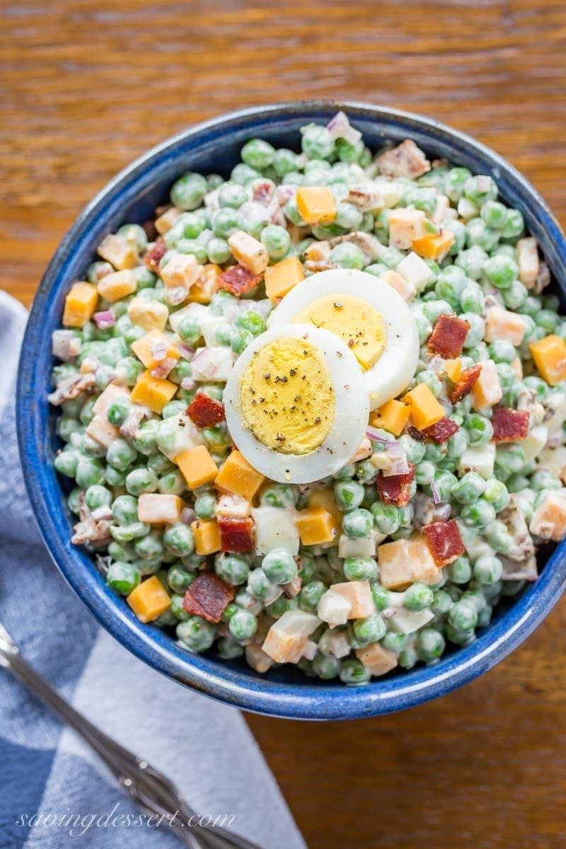 Bowl of English pea salad with boiled eggs, bacon and cheese