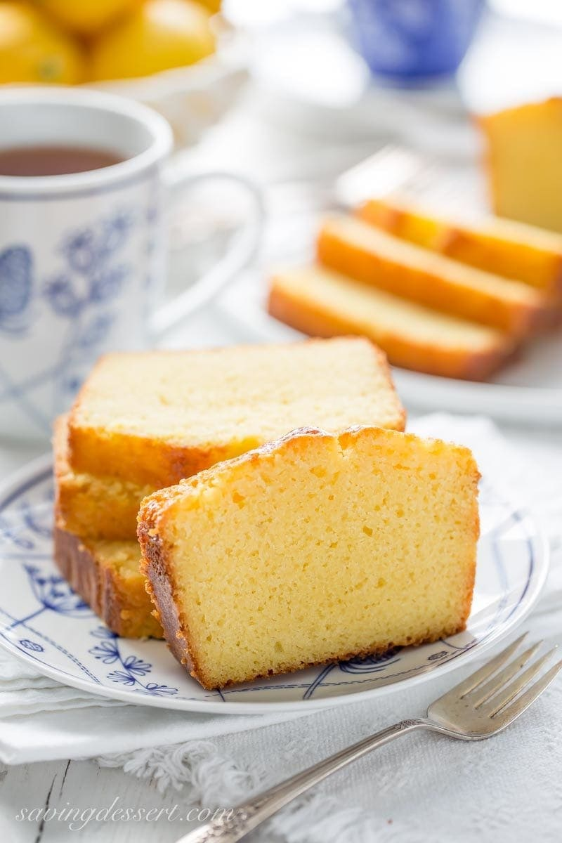 several slices of lemon ricotta pound cake with a cup of tea