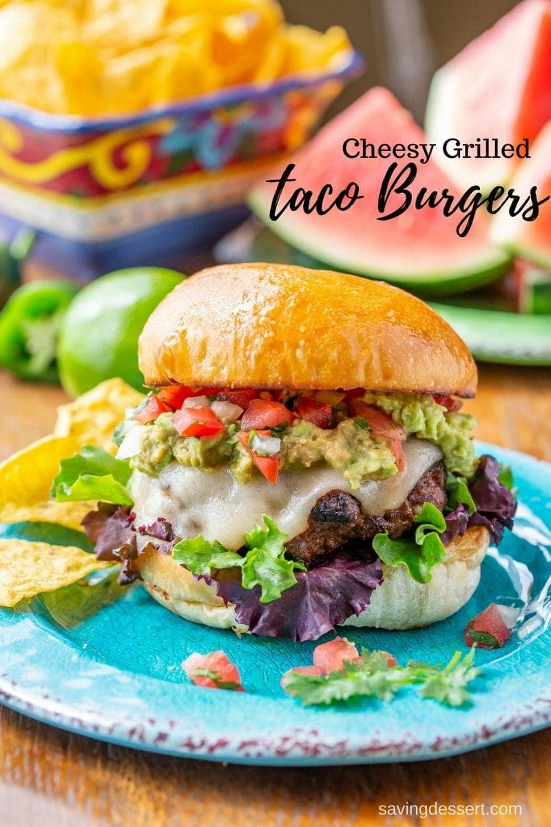 Cheesy Grilled Taco Burgers - all the Mexican flavors you love, in one tasty burger! This is not your same old dried-up burger; it's cheesy and juicy with plenty of flavor without being salty or too intense. #savingroomfordessert #burger #taco #tacotuesday #grilledburger #hamburger #mexicanburger #cheeseburger #tacoburger #mexican