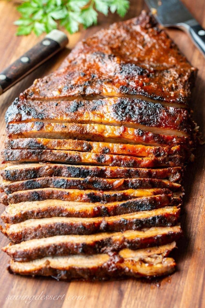BBQ Beef Brisket sliced thin on a cutting board
