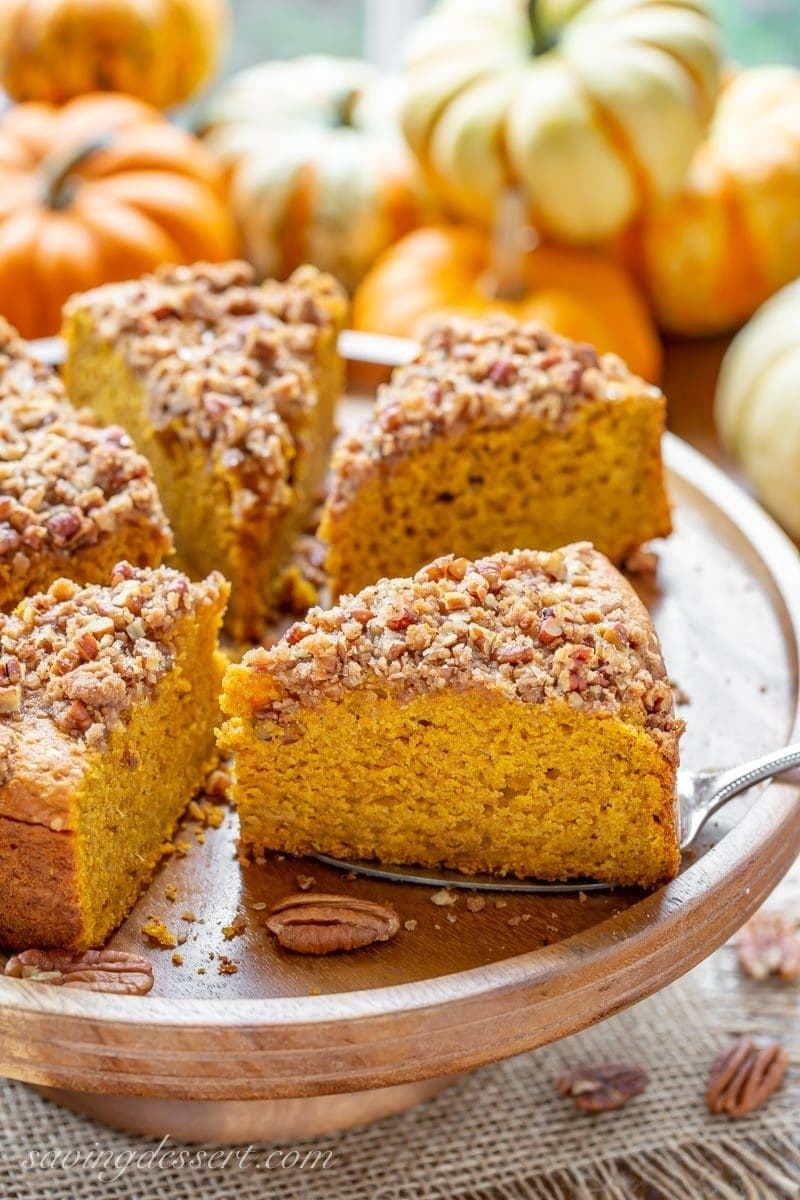 A sliced Pumpkin Breakfast Cake topped with a sweet Pecan Crumble