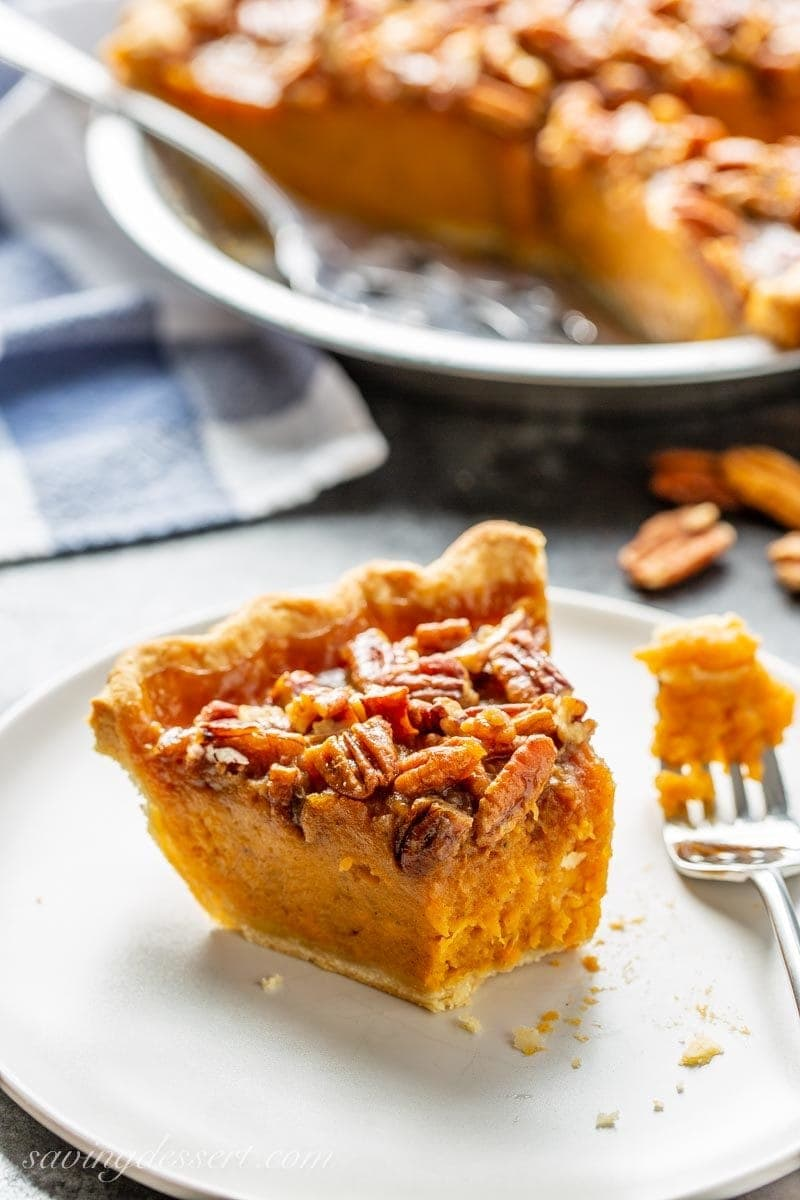 A slice of sweet potato pie with a praline pecan topping