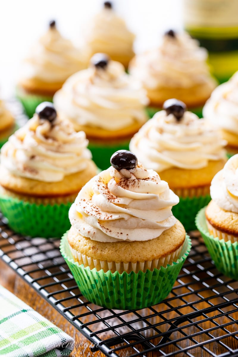Vanilla coffee cupcakes with a swirled icing topped with an espresso bean