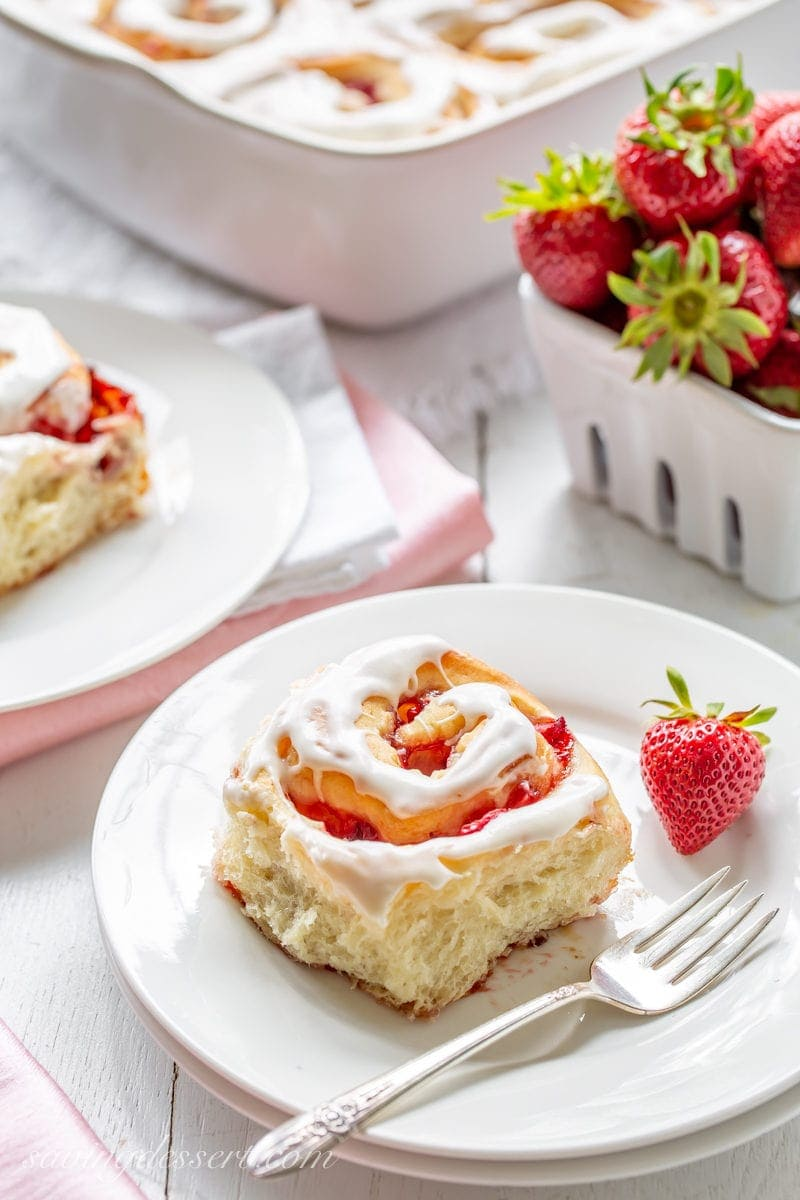 A flaky and soft Strawberry Sweet Roll with fresh strawberries