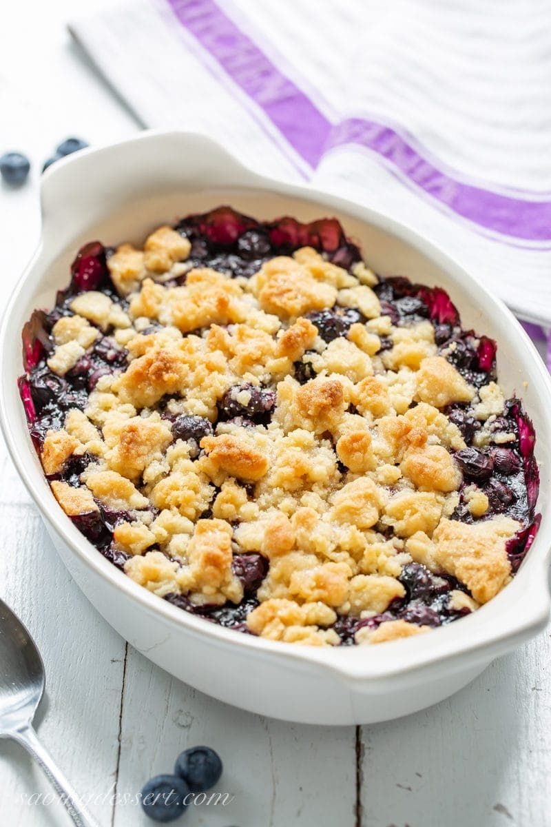 A casserole dish filled with a blueberry crisp