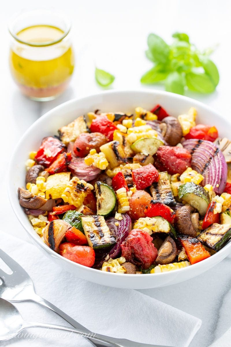 A bowl of chopped grilled vegetables with a simple viniagrette