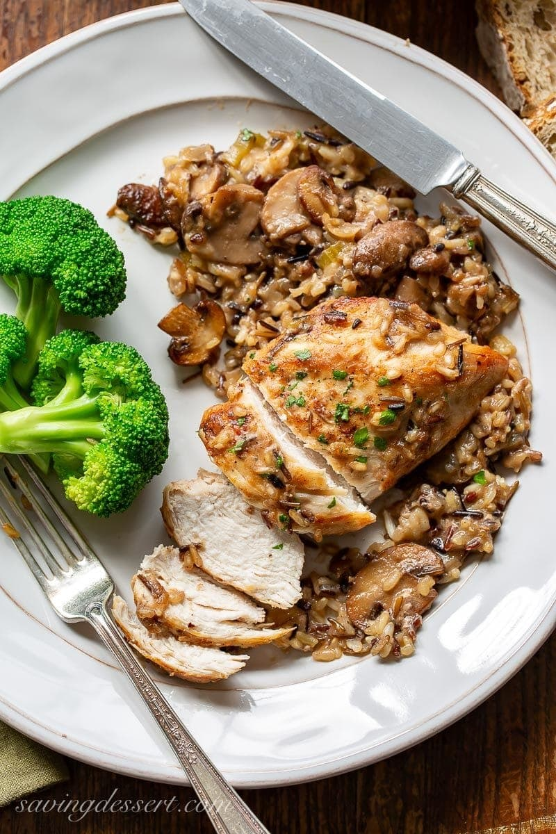 a plate with broccoli, sliced chicken breast and wild rice casserole