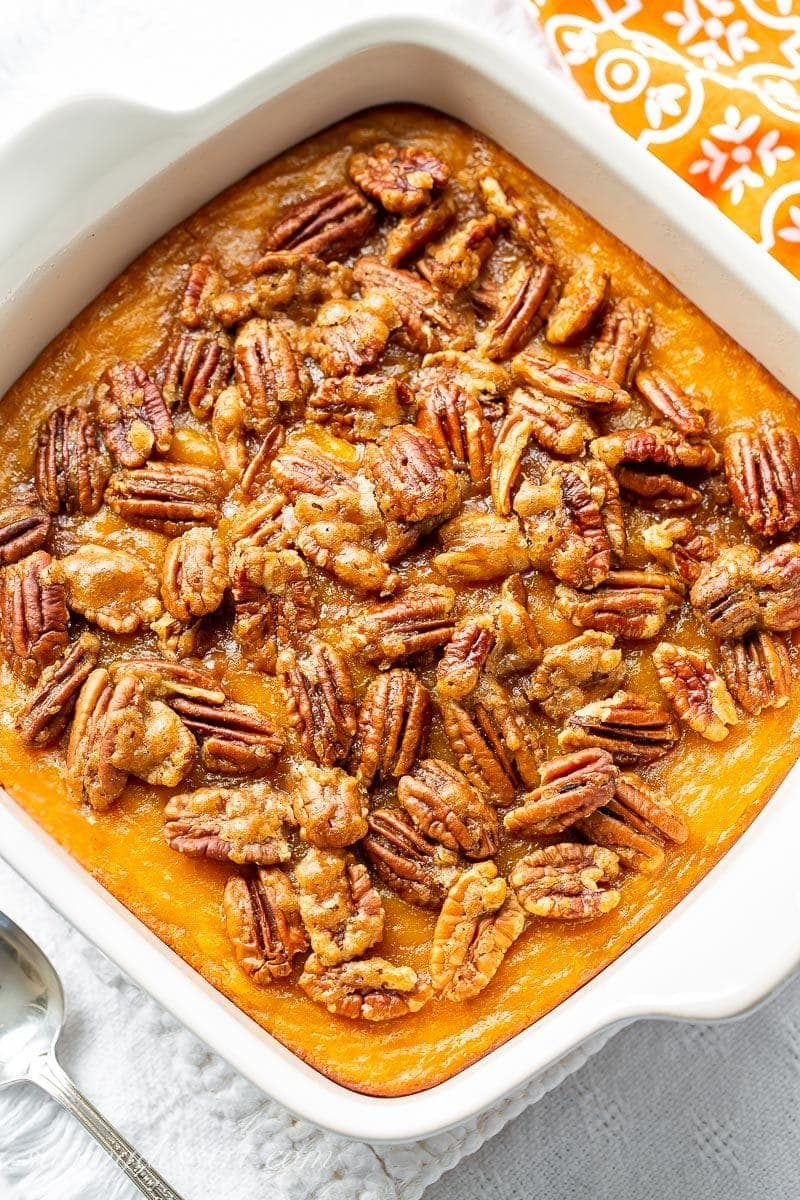 A Butternut Squash Casserole topped with brown sugar cinnamon pecans
