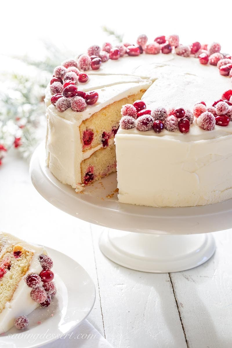Close up of a sliced cranberry layer cake