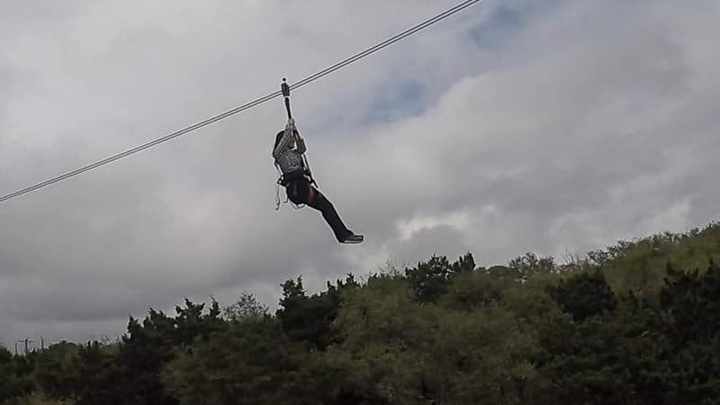 Brooke stuck in the air during her zip-line at Natural Bridge Caverns in Texas