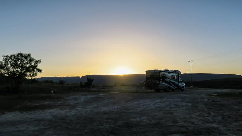 View of our RV with the sun setting