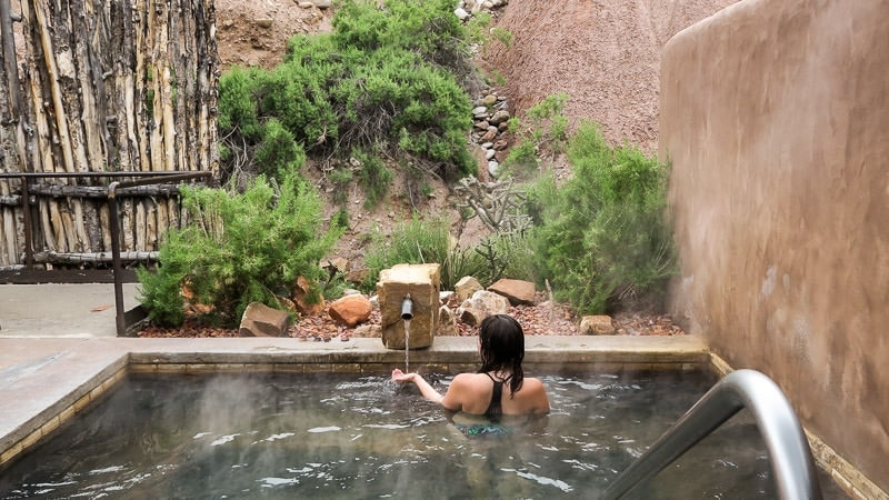 Brooke soaking in the private pool during our romantic getaway at Ojo Caliente Mineral Springs & Spa