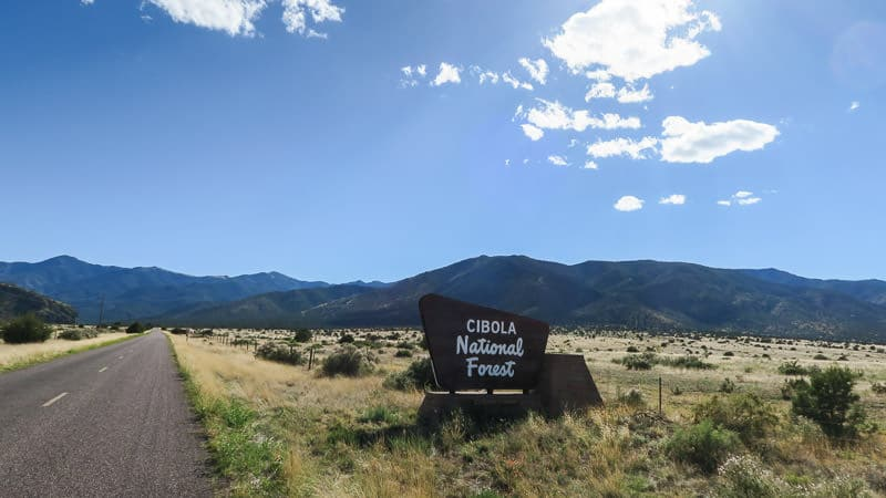 cibola forest sign with mountains and fields