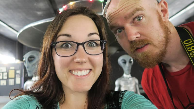 Brooke and Buddy posing with the roswell aliens while visiting Roswell, NM