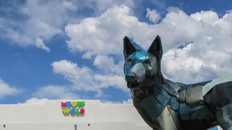 Outside wolf and sign for Meow Wolf in Santa Fe