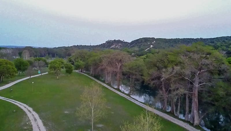 Test flying the drone around a grassy field while learning to slow travel