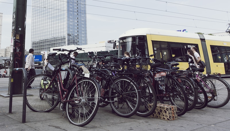 A large crowd of parked bicycles