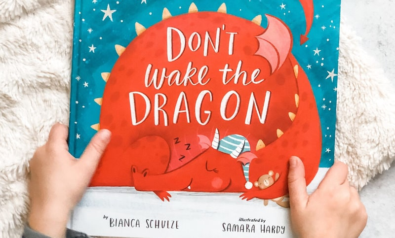 Child Holding Don't Wake the Dragon