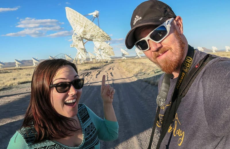 Brooke and Buddy in front of one of the large VLA satellites