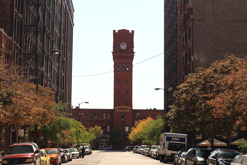 Historic Landmark Chicago Dearborn Station red brick clock tower viewed facing south on Dearborn Street flanked by Printers Row historic buildings