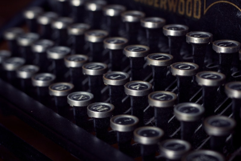 A close-up of typewriter keys.