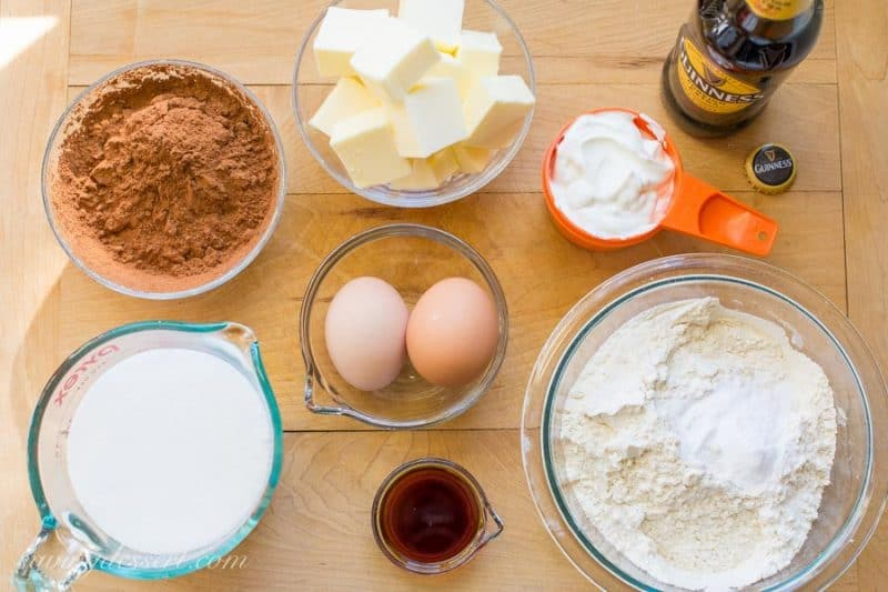 Ingredients set out on a cutting board for a Guinness Chocolate Cake