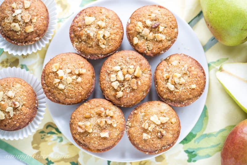 Pear Walnut Muffins - a perfect match with juicy ripe pears and ground walnuts wrapped up in a moist muffin with a great texture and a lightly sweet topping. www.savingdessert.com
