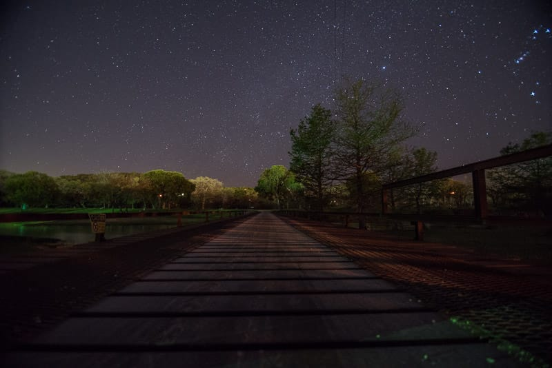 Stars and bridge during a clear night at by the river RV Park in texas