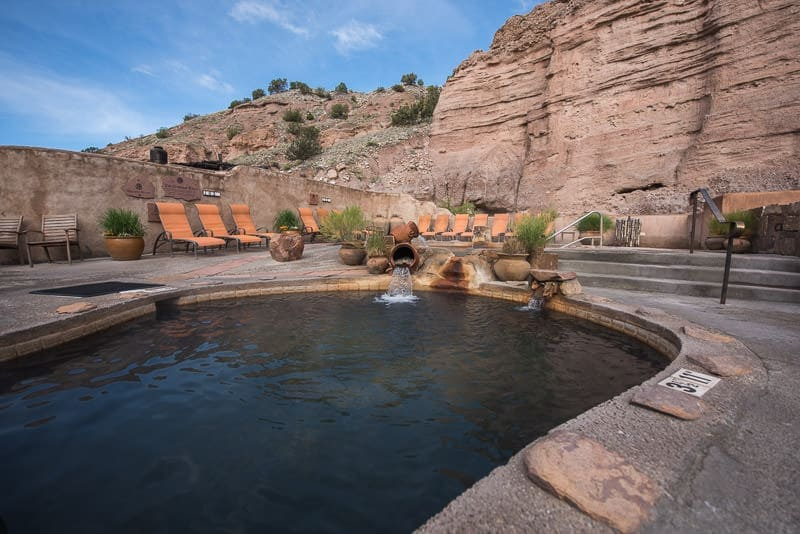 Lovely soaking pool at Ojo Caliente Mineral Springs & Spa with beautiful cliffs