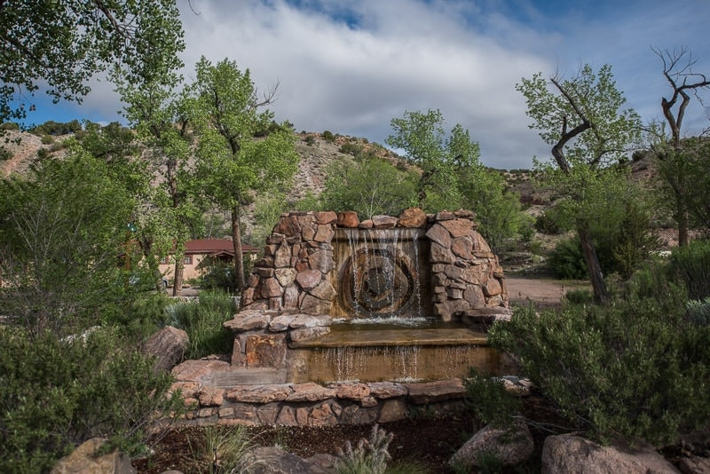 waterfall and sign at entrance to Ojo Caliente Mineral Springs & Spa