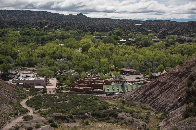 Looking down onto Ojo Caliente Mineral Springs & Spa from the trail that leads to Posi Recreation Area