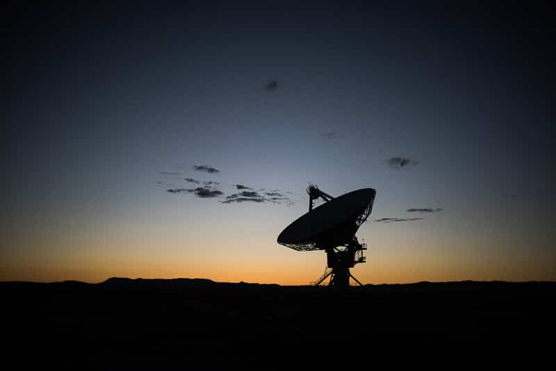 Satellite at sunset at the very large array, new mexico