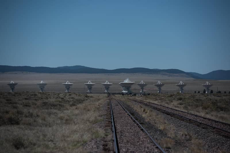 Some of the tracks of the very large array with mountains in the background