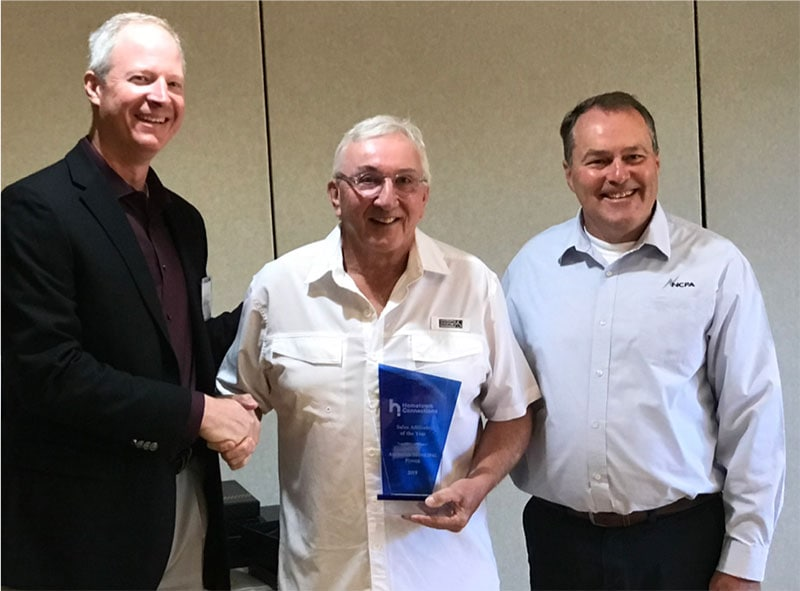 American Municipal Power President & CEO Mark Gerken of accepts the 2019 Sales Affiliate  of the Year Award on behalf the organization. Presented by Hometown President & CEO Tim Blodgett (left) and Board Chair/NCPA General Manager Randy Howard.