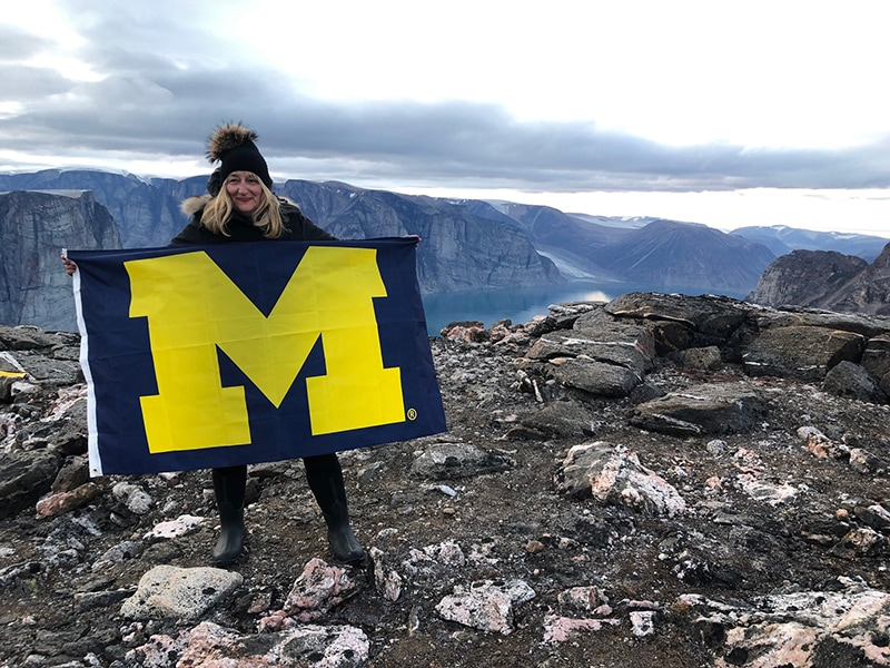 It can get frigid on Baffin Island in Canada, but nothing would stop Andrea Fischer Newman, '79, from flying the U-M flag.