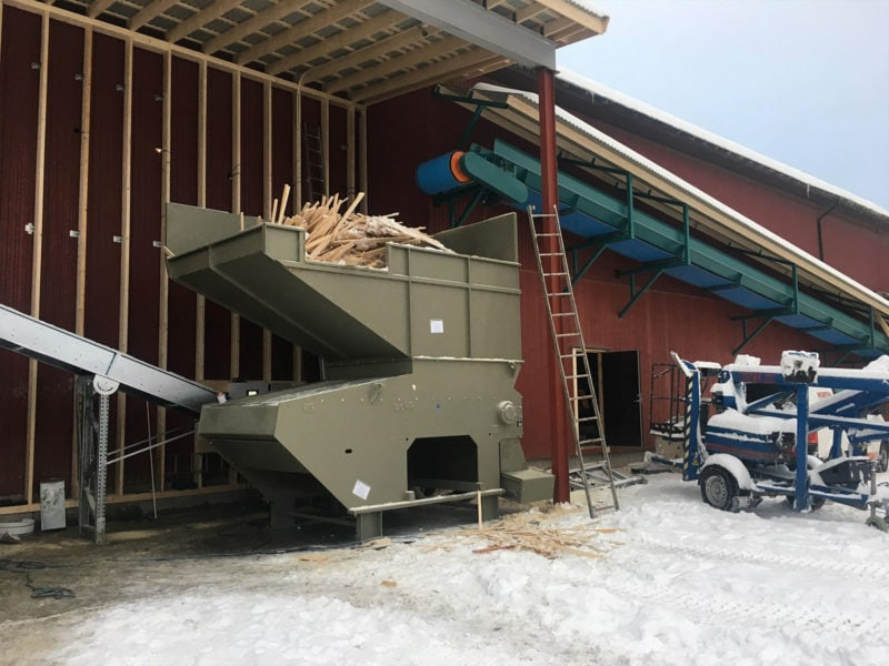 Big Hopper Shredder Full Of Waste Wood With Band Conveyor In A Snowy Landscape