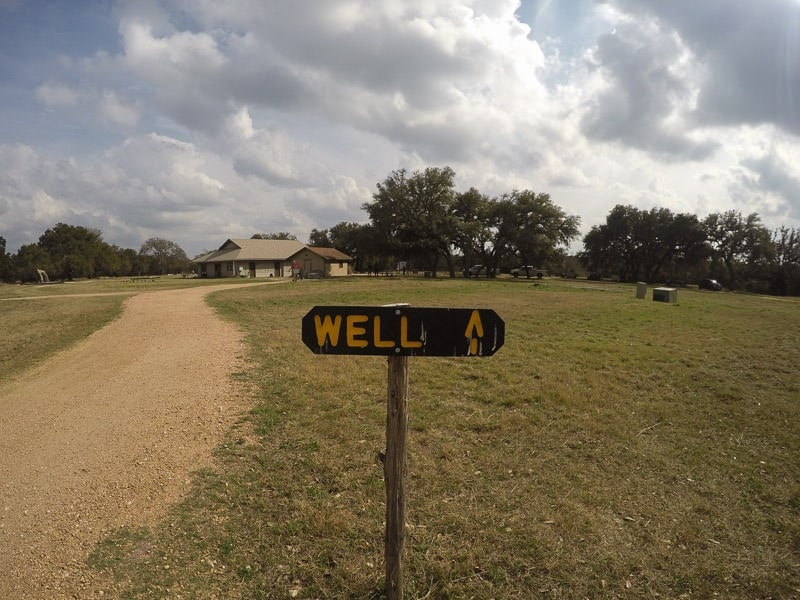 Just a simple sign that says 'Well' and an arrow