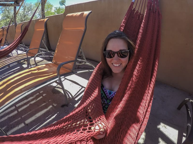 Brooke cuddled up in a hammock after a warm soak