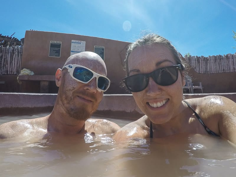 Brooke and Buddy soaking in the mud pool at Ojo Caliente