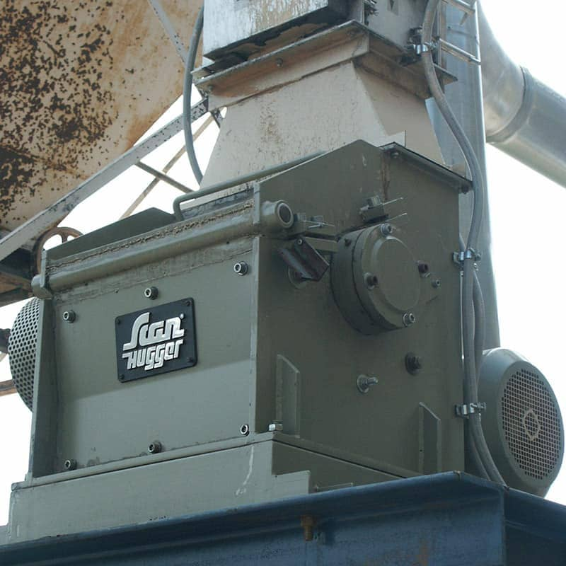 Closeup of Industrial wood shredder in a turnkey system made for waste wood shredding for briquetting and pellets