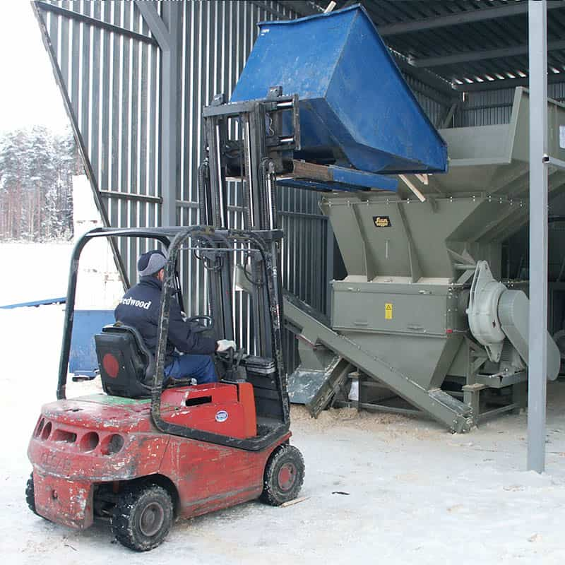 waste wood recycling - hl 41413 at woodworking plant in norway being loaded with off cut wood