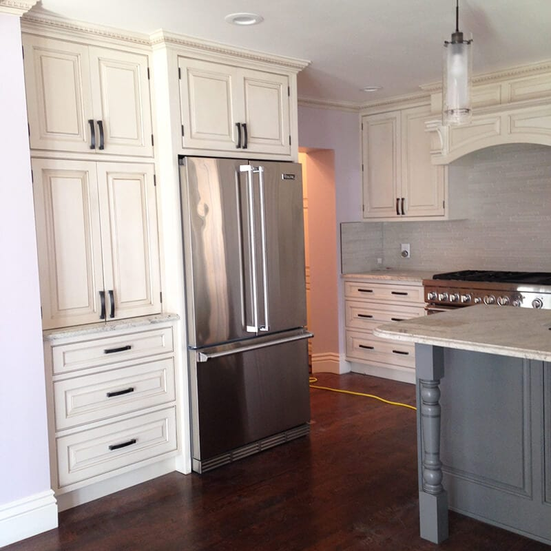 Traditional cabinets with stainless steel fridge in remodel of kitchen in Denver