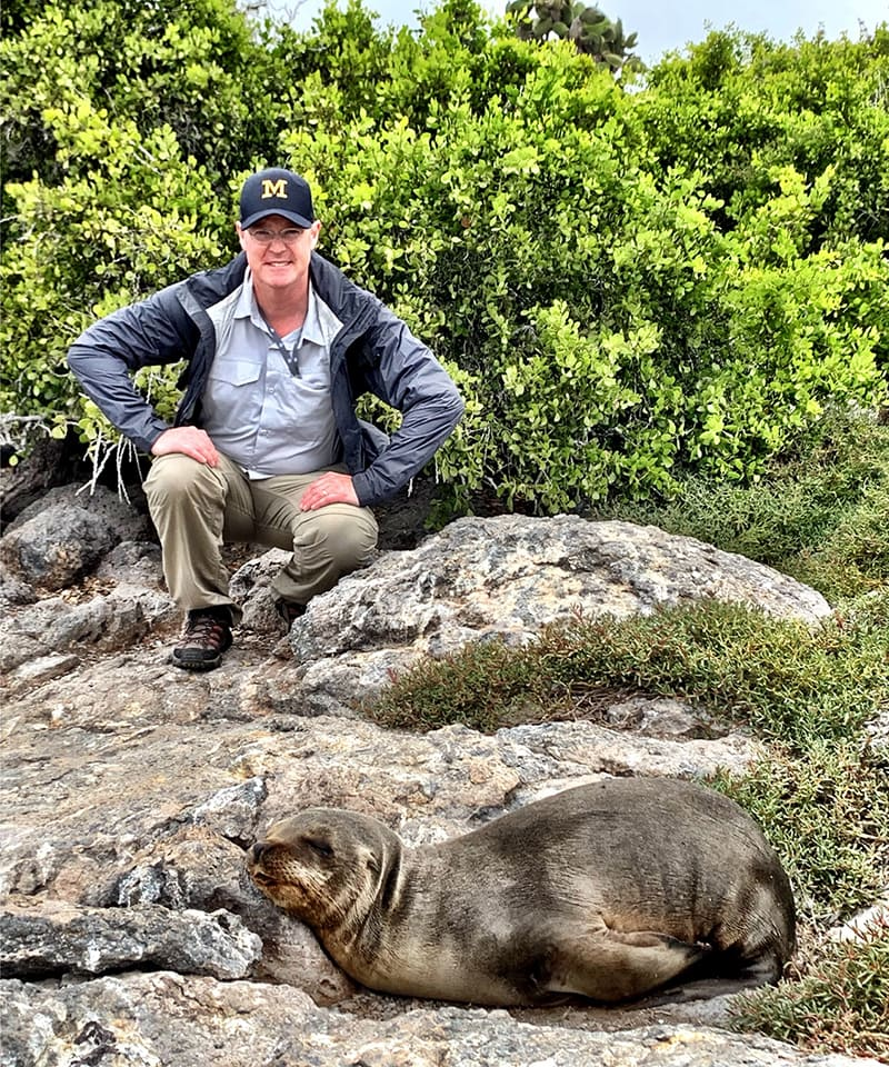 Jeff Hartgen, '91, chilled out with a sea lion on the Galápagos Islands.